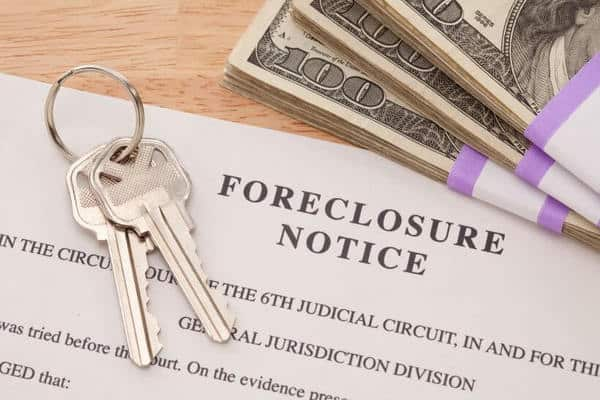 foreclosure notice documents with keys and cash