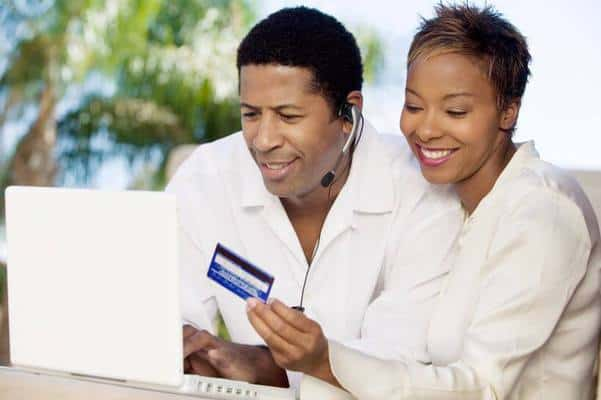 black couple wife holding credit card